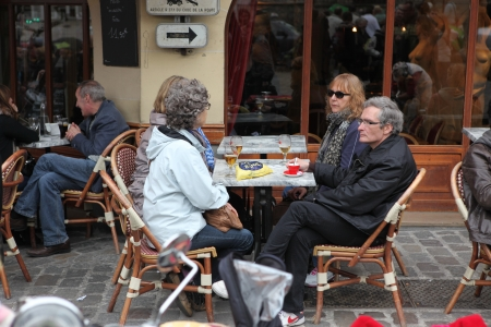 PARIS - MAY 1  View of typical paris cafe on May 1, 2013 in Paris  Montmartre area is among most popular destinations in Paris, many artists worked around the community of Montmartre such as Pablo Picasso or Vincent van Gogh