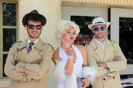 BARCELONA SPAIN - JUNE 16: impersonator Marylin Monroe and boys in Barselona Spain 16 June 2013. Marylin was an American pop icon of 60x, actress, model and singer. Her type is very popular also nowadays