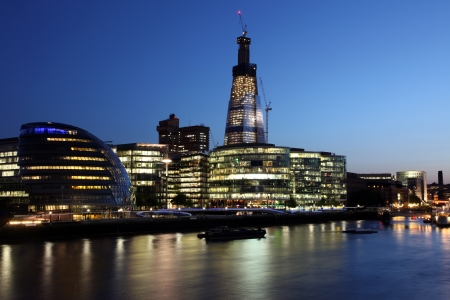London at twilight and Thames with ships, UK