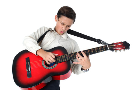 passionately: young guitar player performing very passionately  Stock Photo
