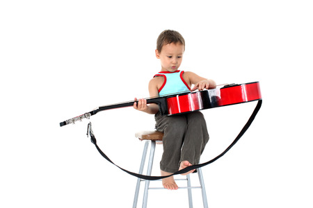 4 year old: young guitar player 4 year old on a white background