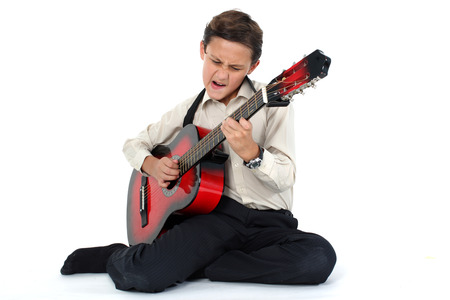 passionately: young guitar player performing very passionately on a white background