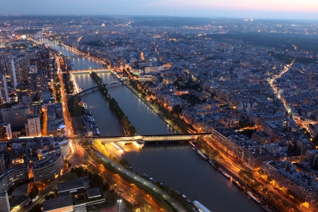 Famous Night view of Paris with the Seine river from the Eiffel Tower, France photo
