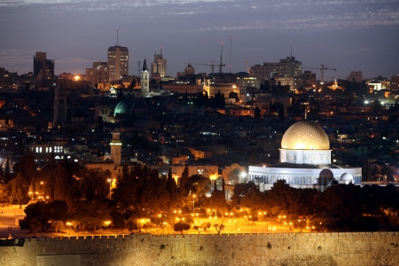 Classic Night view of Temple Mount with Dome of the Rock and old city from the Mt of Olives in Jerusalem, Israel photo