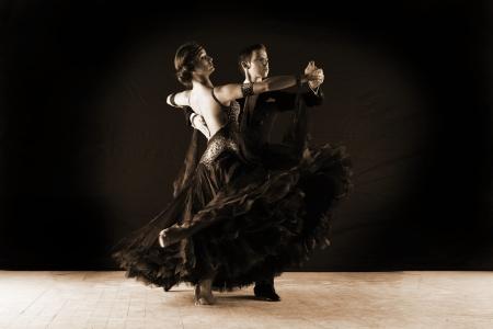 couple dancing: Latino dancers in ballroom isolated on black