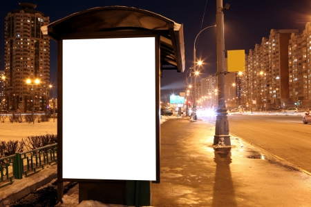 Blank sign at bus stop at evening in city 版權商用圖片