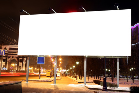 Empty roadside billboards at evening in city photo