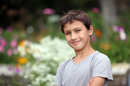 10 years old: boy 10 years old against summer flower