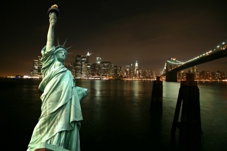 Statue of Liberty against night New York city, USA photo