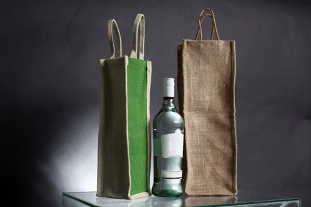 bag for water or alcohol made out of recycled Hessian sack with bottle photo