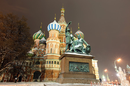 The monument to Minin and Pozharsky in front of the most famous Russian Cathedral on the Red Square in Moscow winter photo