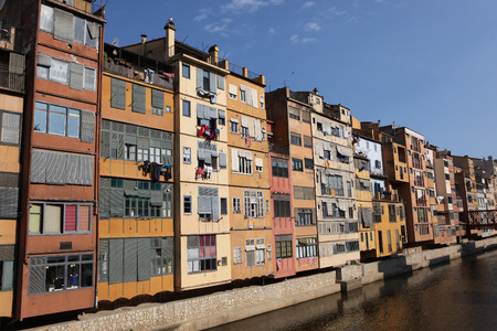 View of the old town with colorful houses reflected in water Jewish quarter in Girona. Catalonia. Spain