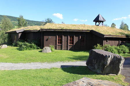 Small houses with traditional Norwegian grassy roofs photo