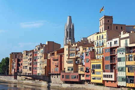 jewish houses: View of the old town with colorful houses reflected in water Jewish quarter in Girona. Catalonia. Spain Stock Photo