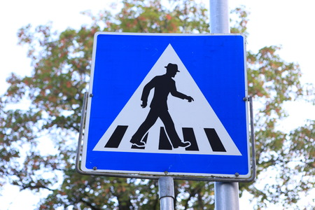 funny pedestrian crossing sign in hat photo