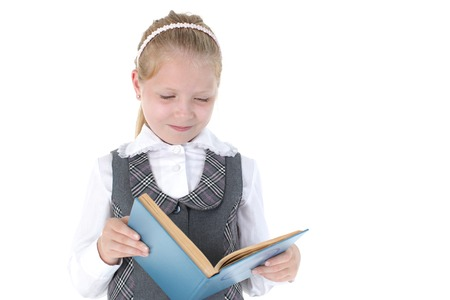 8 year old: 8 year old school girl read book on white background