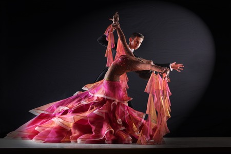 male ballet dancer: Latino dancers in ballroom isolated on black background
