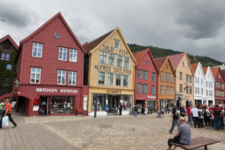 major ocean: BERGEN, NORWAY - CIRCA JULY 2012: Tourists and locals stroll along the UNESCO World Heritage Site, Bryggen, July 2012 in Bergen. Bergen is the second largest city in Norway Population (2013) - 268,700