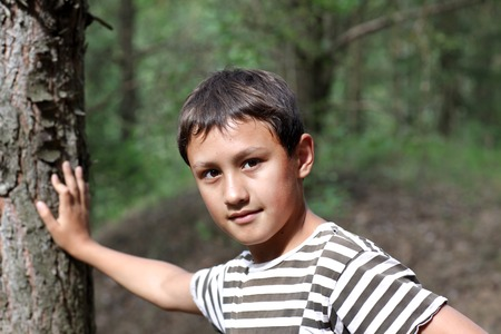 10 years old: little boy 10 years old against forest