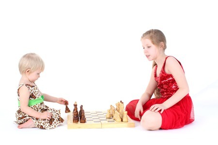 9 year old: adorable little two sisters 9 year and  1  year old learning play in chess