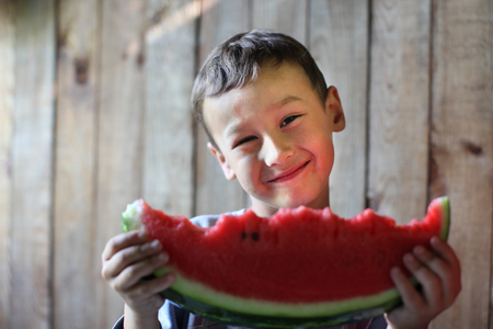 The boy with water-melon photo