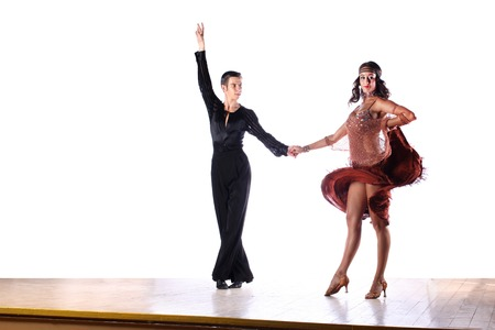 latin couple: Latino dancers in ballroom against white background