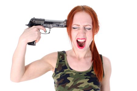 holding gun to head: Young Woman holding Handgun