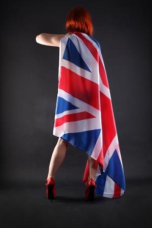 woman holding an UK flag