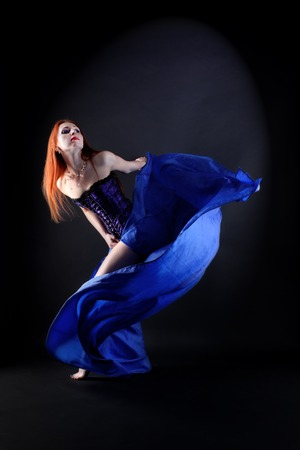 prowess: woman modern dancer in ballroom