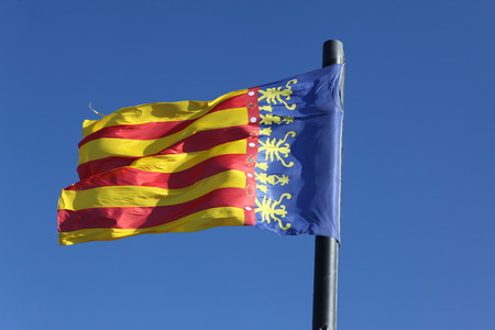 autonomic: Flag of Comunidad Valenciana, region in Spain, moving in the wind