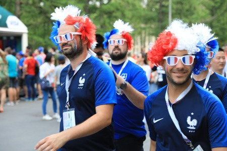 MOSCOW, RUSSIA - June 26, 2018: French and Denmark fans celebrating during the World Cup Group C game between France and Denmark at Luzhniki Stadium Editorial