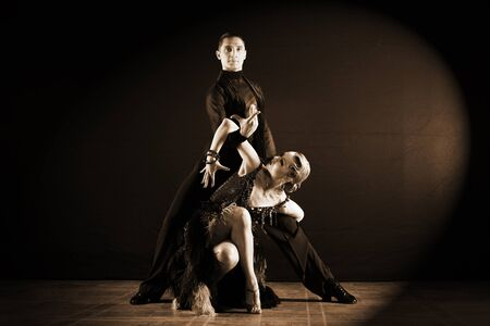 dancers in ballroom isolated on black background Stock Photo