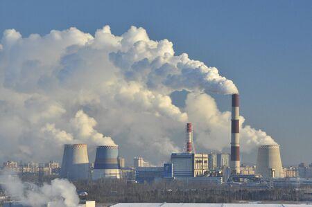 Thermal power station, white smoke, blue sky background, frosty Sunny morning, Saint Petersburg