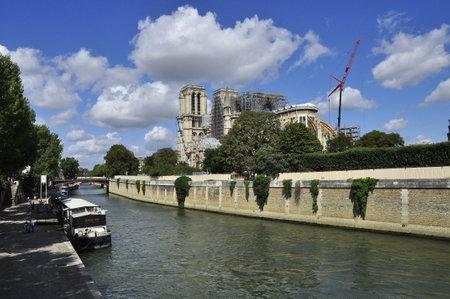 Notre Dame de Paris under restoration, view from the Seine river embankment.