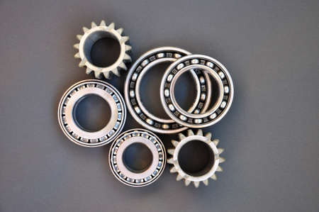 Various bearings and gears on a black background