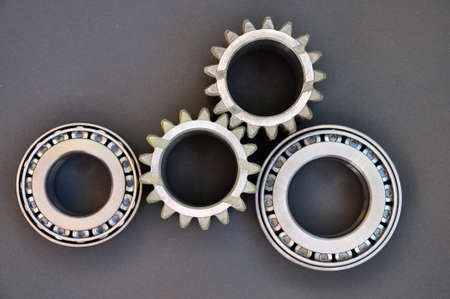 Bearings and gears on a black background