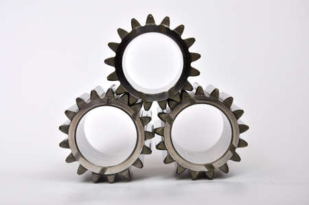 Three gears on a white background.