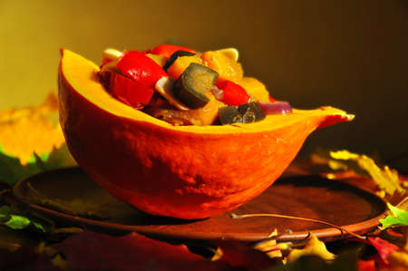 Vegetable stew in a bowl made from pumpkin.