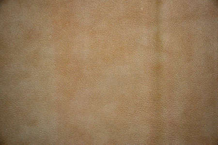 Brown leather for furniture. Background. Design of leather upholstery of furniture.