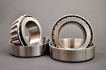 Roller bearings on a dark background. Spare parts