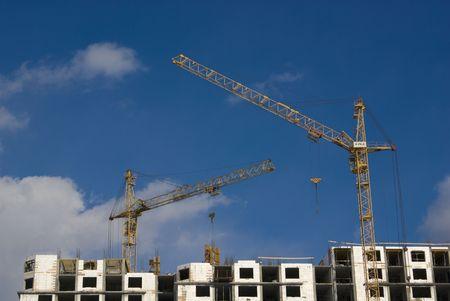 Building site under blue sky. This picture symbolizes: rapid growth, development, construction process, design realization. Stock Photo - 2825514