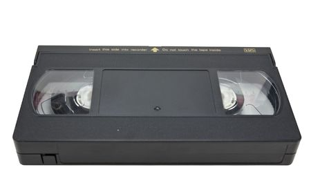 video still: Black VHS cassette, no label, isolated on white