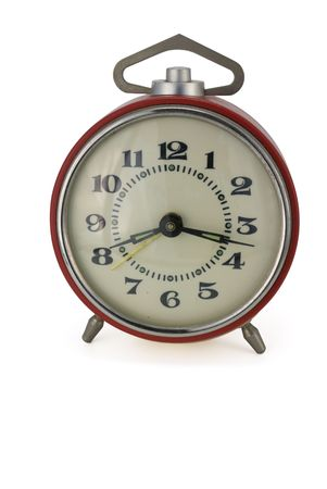 Red mechanical alarm clock isolated on white photo