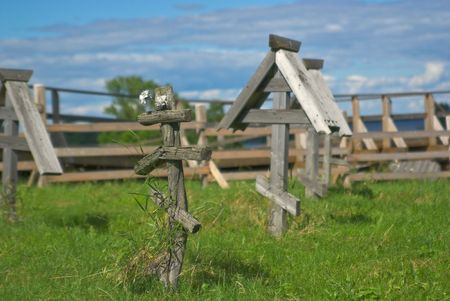 cemetry: Lonely and broken wooden cross on old orthodox cemetry Stock Photo