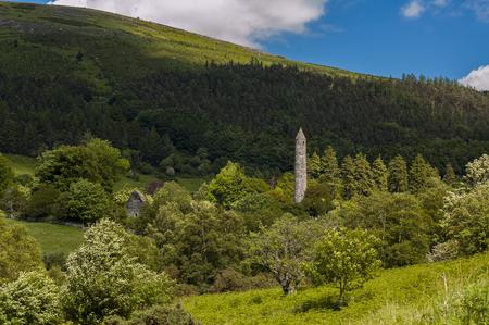 Round tower and church in Glendalough, Ireland