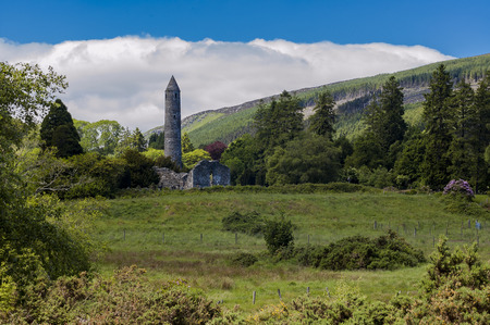 medeival: Round tower and ruin of church in Glendalough, Ireland