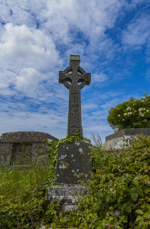High cross over old grave Stock Photo