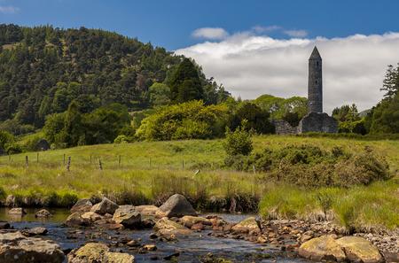 Round tower and ruin of church in Glendalough, Ireland