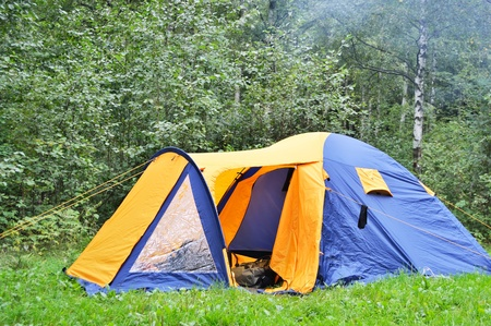 camping tent in summer forest photo