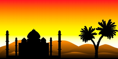 Landscape: the silhouette of a mosque in the desert at sunset